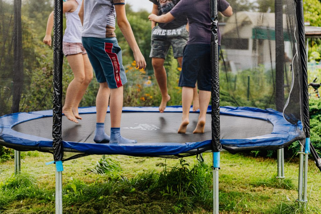 kids playing on a trampoline at christmas