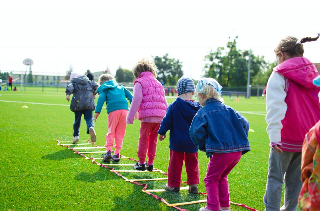 kids playing safe social distancing games outside